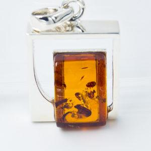 Silver pendant with rectangular cognac amber A2A38