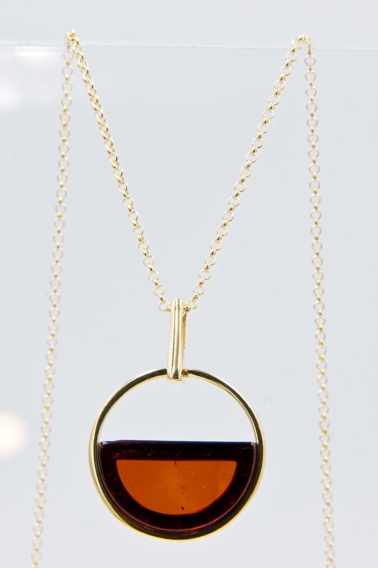 Elegant necklace with semicircular cognac amber Z1A48
